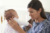 image of natal  - Frustrated Mother Suffering From Post Natal Depression - JPG