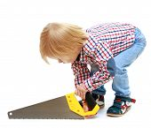 picture of montessori school  - Little boy sawing saw - JPG