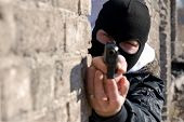 image of glock  - Criminal in black mask targeting at you with semi - JPG