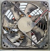 pic of aeration  - Dusty Ventilator Fan in Computer Power Supply Closeup - JPG