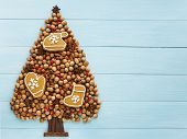 stock photo of hazelnut tree  - Christmas tree made of nuts cinnamon and anise - JPG