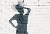 stock photo of fool  - Funky girl fooling around on the brick wall background - JPG