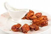 stock photo of chicken wings  - chicken wings with sauce closeup at white plate - JPG