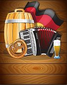 picture of accordion  - Accordion beer barrel glass pretzel and German flag on a wooden background - JPG