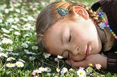 Girl sleeping in meadow