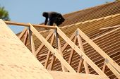 foto of rafters  - A roofing contractor installing rafters at a commercial residential development - JPG