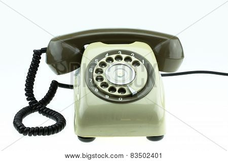 Old telephone or vintage telephone on white background.