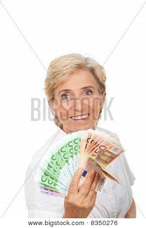 Sucesso sênior com punhado de dinheiro