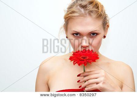 Girl Smelling Red Flower