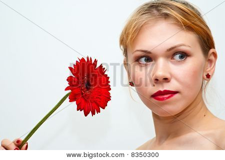 Beautiful Young Woman With Red Flower