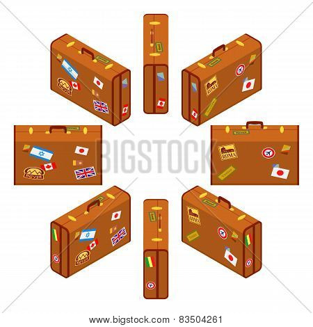 Set of standing brown traveler`s suitcases