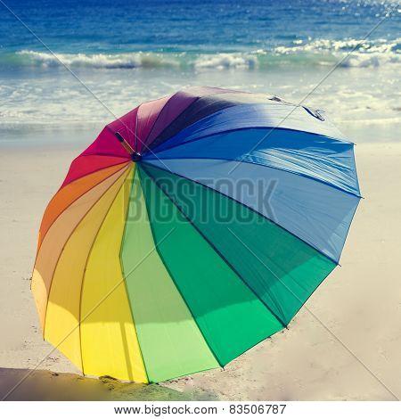 Rainbow Umbrella By The Ocean