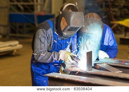 Two Steel Construction Workers Welding Metal
