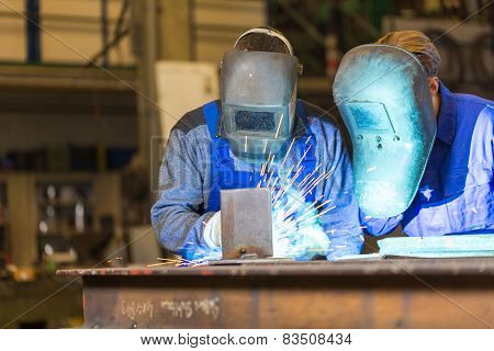 Two Steel Construction Workers Welding Metal