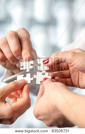 Four Hands Fitting Together Matching Interlocking Puzzle Pieces