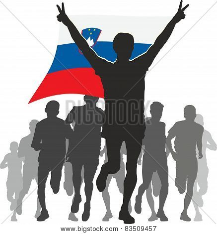 Athlete with the Slovenia flag at the finish