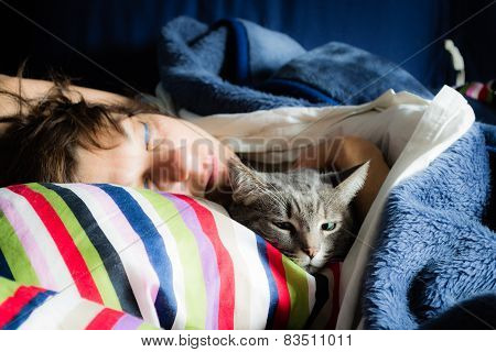 Woman Sleeping With Cat