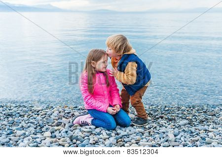 Adorable children playing together outdoors