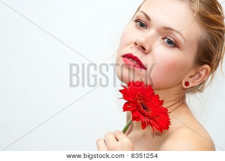 Sensual Beautiful Girl With Red Flower