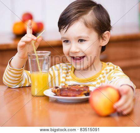 Little Boy With Glass Of Orange Juice