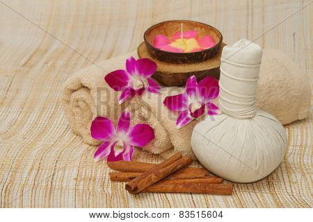 Spa Massage Setting With Herb, Towel, Compress Balls And Aroma Candle