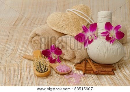 Spa Massage Setting With Herb, Towel, Compress Balls And Salt Scrub