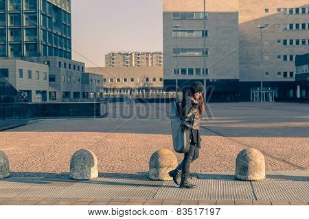 Beautiful Young Woman Carrying Saxophone Case