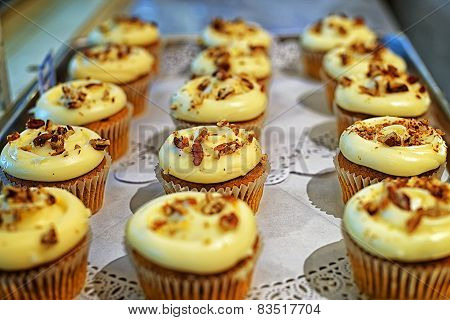 Creamy Cupcakes With Nuts On The Storefront