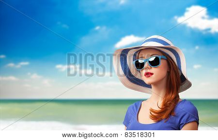Redhead Girl With Sunglasses And Hat
