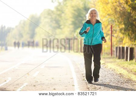 Senior Woman Doing Exercises Outdoors
