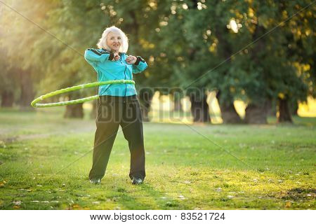 Healthy Senior Woman Doing Exercises In Nature
