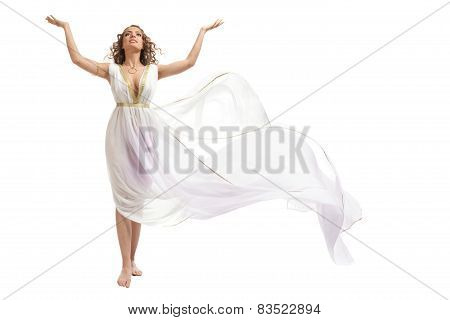 Classical Greek Goddess In Tunic Raising Arms