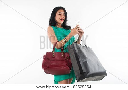 Shopaholic girl spending her money for branded item