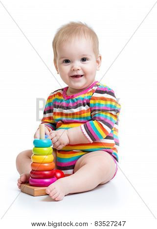 baby playing with pyramid toy