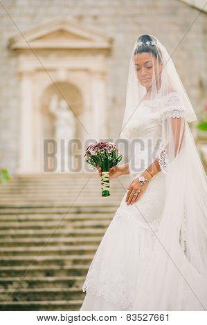 Bride Portrait With Bouquet And Veil