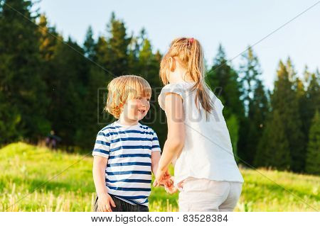 Adorable kids playing outdoors