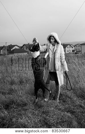 woman playing with staffordshire terrier
