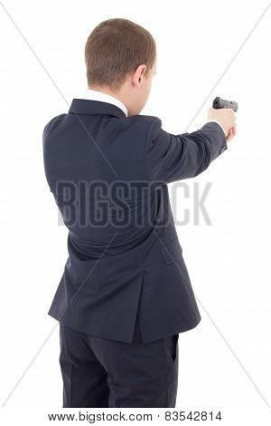 Back View Of Man In Business Suit Shooting With Gun Isolated On White