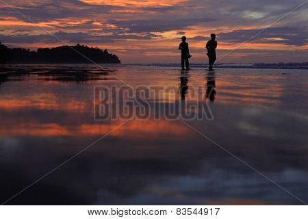 Silhouettes On The Beach