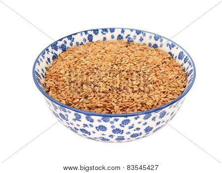 Golden Linseed Or Flax Seeds In A Blue And White China Bowl