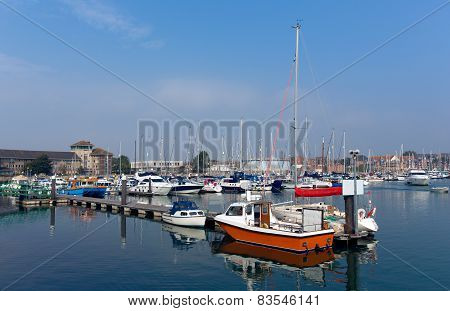 Weymouth marina North Quay Dorset UK with boats and yachts on a calm summer day