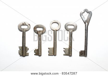 Five Old Keys To The Safe On A White Background