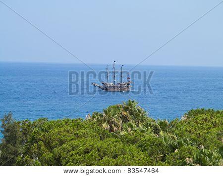 Vintage Wooden Old Ship In Blue Sea