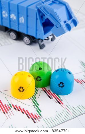 Colored Trash Bins And Garbage Truck Toys On Business Background