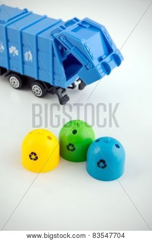 Colored Trash Bins And Garbage Truck Toys On White Background