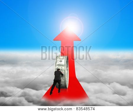 Businessman Pushing Money Circle On Red Arrow With Sunlight Cloudscape