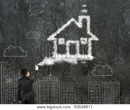Businessman Spraying House Shape Cloud Paint With Cityscape Doodles Wall