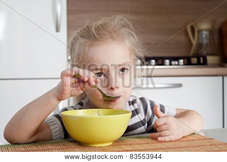 Little Girl Is Thinking While Eating