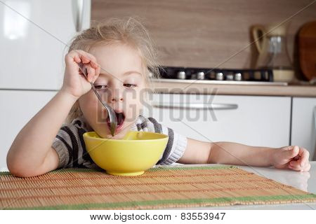 Littke Girl Is Thinking While Eating And Doesn't Want To Eat