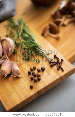 Closeup On Pepper Garlic And Rosmarinus On Cutting Board